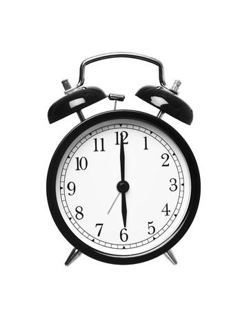 경보: Alarm clock shows six o`clock isolated on white background