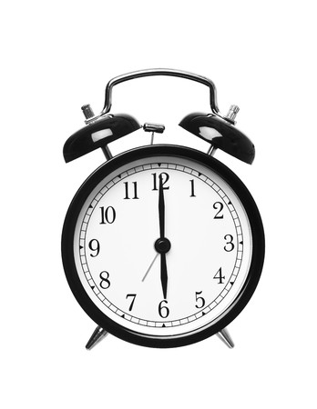 checking the time: Alarm clock shows six o`clock isolated on white background