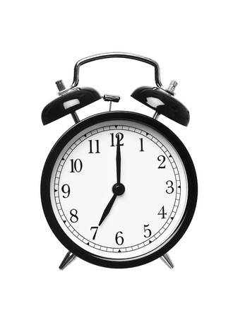 seven o'clock: Alarm clock shows seven o`clock isolated on white background Stock Photo