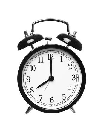 o�??clock: Reloj despertador muestra las ocho aislados en fondo blanco Foto de archivo