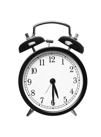 Alarm clock shows half past five isolated on white background Stock Photo - 7977506