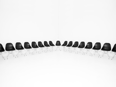 Black chairs in a row isolated on white background photo