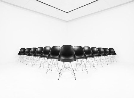 Black chairs isolated in a white room photo