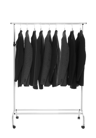 skirt suit: Suits on a Dress Rack isolated on white background