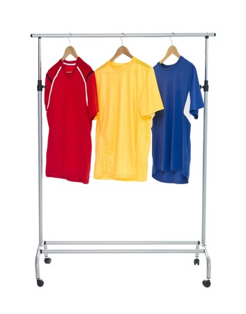 Colored shirts on a Clothes Rack isolated on white background Stock Photo - 8035527