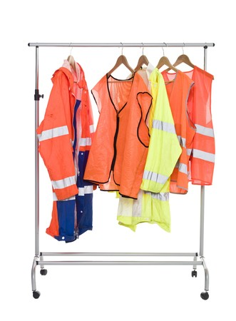 Colored Workwear hanging on a Clothes Rack isolated photo