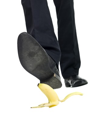 Banana peel slip isolated on white background photo