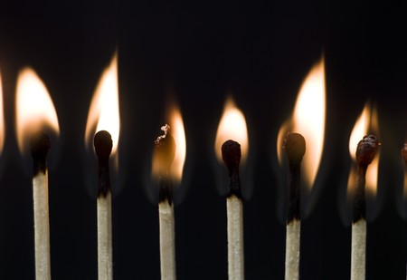 Group of Matches on black background photo