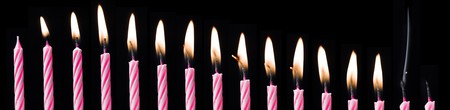 Time Lapse of a Birthday Candle on black background photo