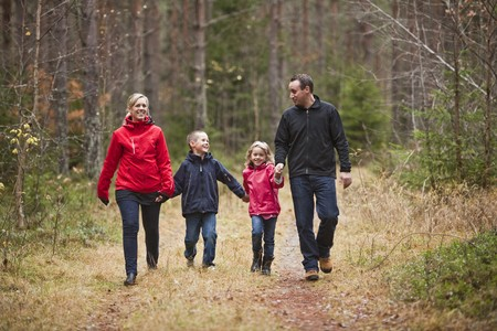 Family walking in the woods photo