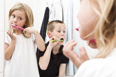 teeths: Siblings brushing teeths in the bathroom