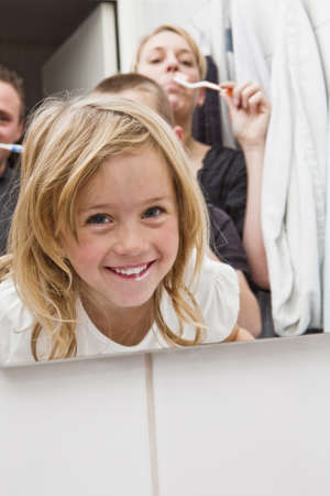 family medicine: Family brushing teeths in the bathroom