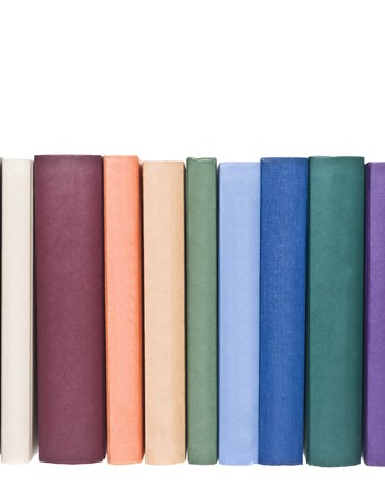 Books in a row isolated on white background Stock Photo - 8161373