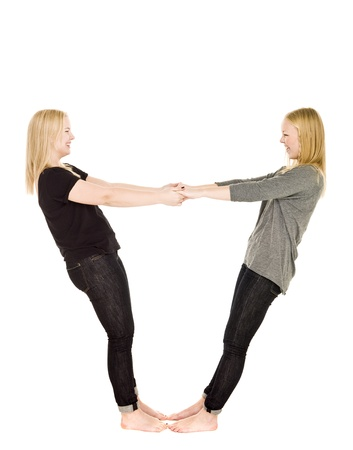 Two girls holding each others hands Stock Photo - 8308539