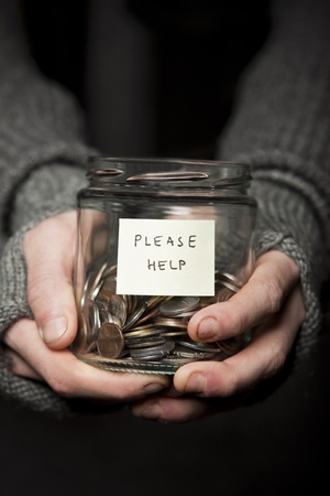 giving money: Close up of a Beggars hands and jar of coins