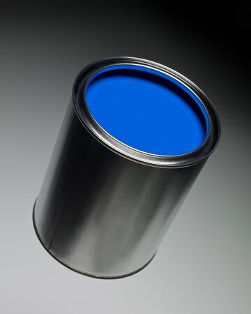 Blue Paint can on toned background photo