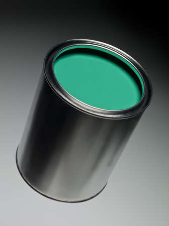Green Paint can on toned background photo