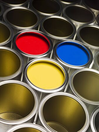Full Frame of Paint Cans with red, yellow and blue paint photo