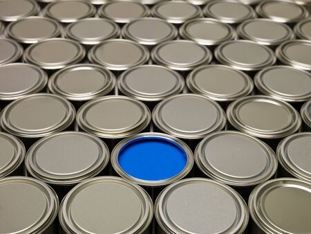 Full Frame of Paint Cans, one filled with blue paint photo