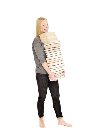 Young girl carrying a pile of books isolated on white background photo
