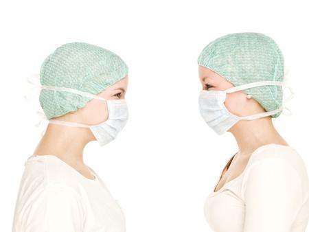 surgical mask woman: Two Female nurses isolated on white background