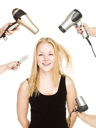 Happy Girl with Hair Equipment around isolated on white background photo