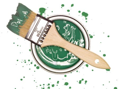 paintcan: Green Paintcan and brush from above isolated on a spotted background