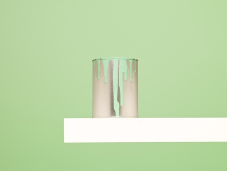 paintcan: Paintcan with spill on green background Stock Photo