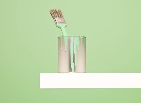 paintcan: Paintcan and Paintbrush with spill on green background Stock Photo