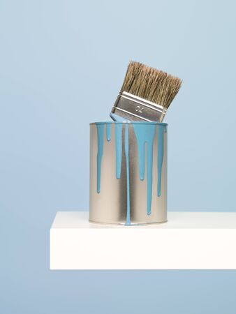 paintcan: Paintcan and brush on blue background