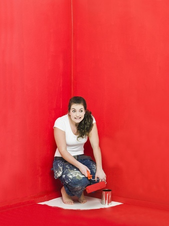 Girl has painted herself in the corner Stock Photo - 8930475