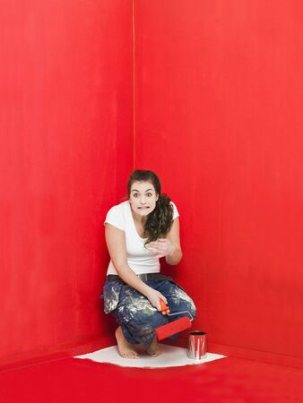 Girl has painted herself in the corner Stock Photo - 8930483