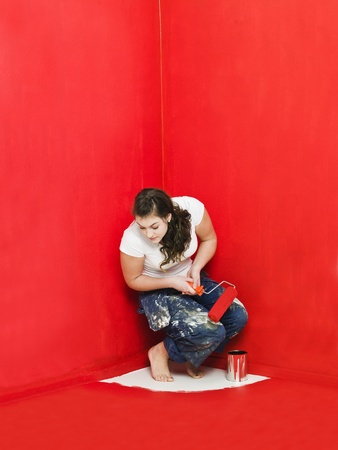 Girl has painted herself in the corner Stock Photo - 8930467