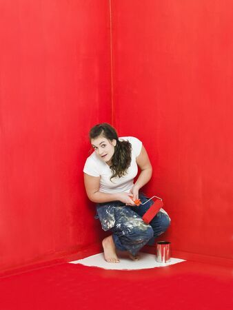 Girl has painted herself in the corner Stock Photo - 8930481