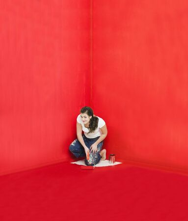 Girl has painted herself in the corner photo