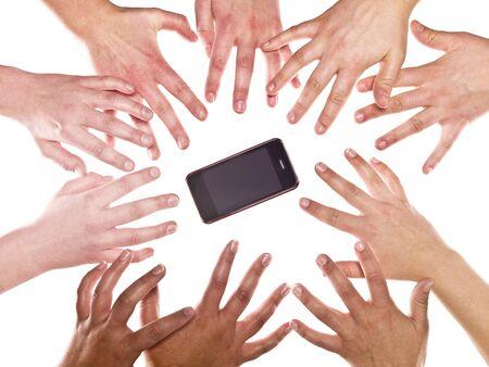 Grupo grande de manos humanas y un teléfono celular Foto de archivo