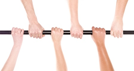 Six human hands holding the same stick Stock Photo - 8930417
