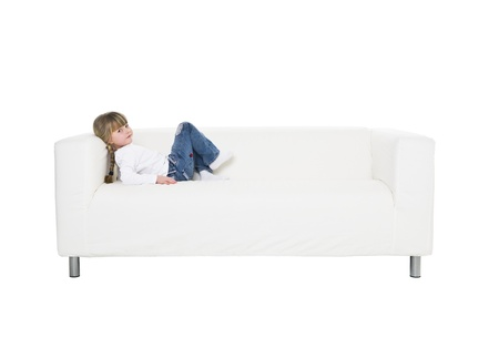 Young girl in a sofa isolated on white background Stock Photo - 8930505