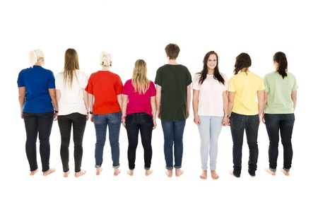 People in a row with one of them facing the camera
