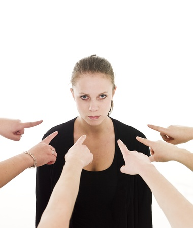 Group of Hands pointing at a woman on white background photo