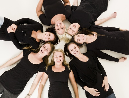 Group of Young Women lieing in a circle on white background Stock Photo - 9193978