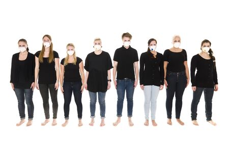 Girls in a row with Protective Masks isolated on white background Stock Photo - 9189715