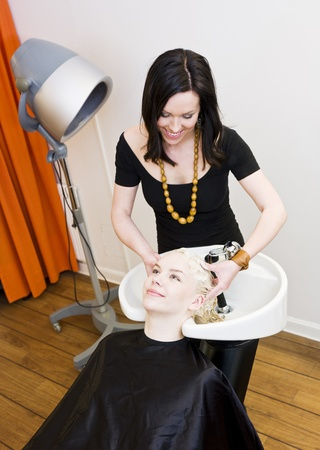 Hairdresser washing customers hair at a Beauty Spa photo