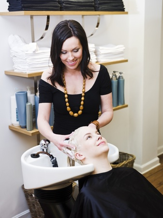 Hairdresser washing customers hair at a Beauty Spa Stock Photo - 9288965
