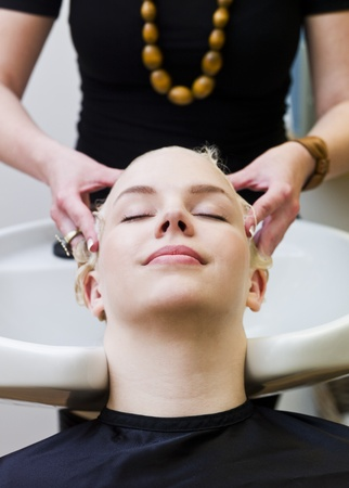 Hairdresser washing customers hair at a Beauty Spa Stock Photo - 9289012