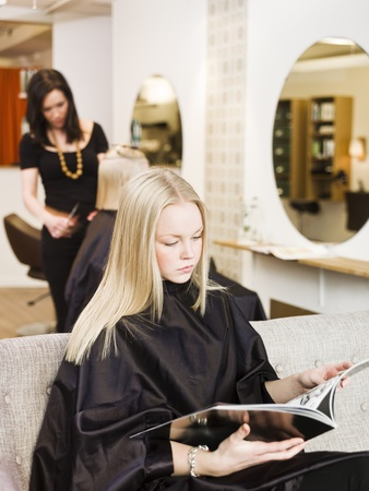 paper cutting: Young girl waiting at the Beauty Spa
