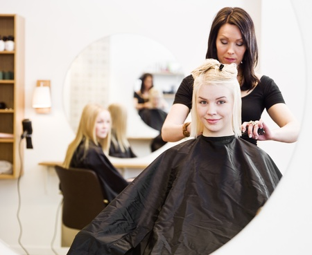Young Blond Girl in the Hair Salon Stock Photo - 9288969