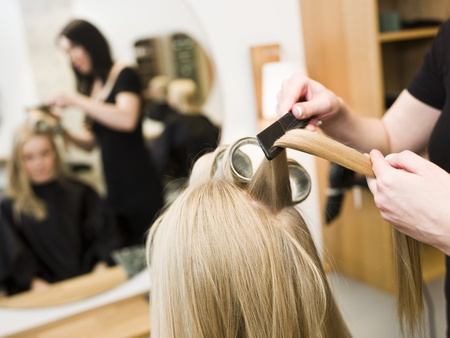 Hairdresser in action with blond customer close up Stock Photo - 9289016