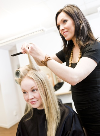 Hairdresser in action with blond customer Stock Photo - 9289009
