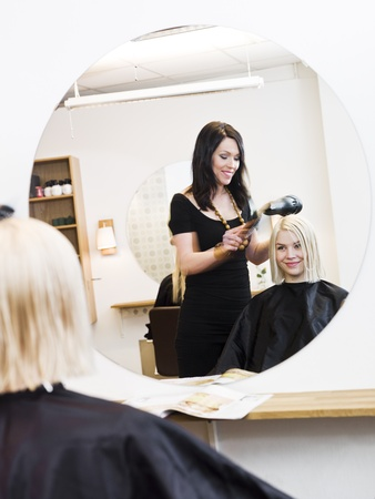 Hairdresser in action with blond customer Stock Photo - 9288968